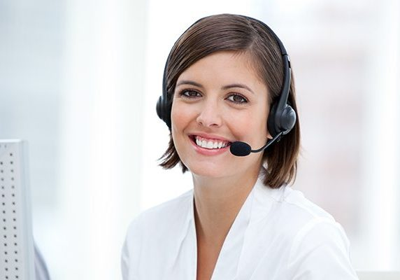Portrait of a pretty customer agent at work in the office